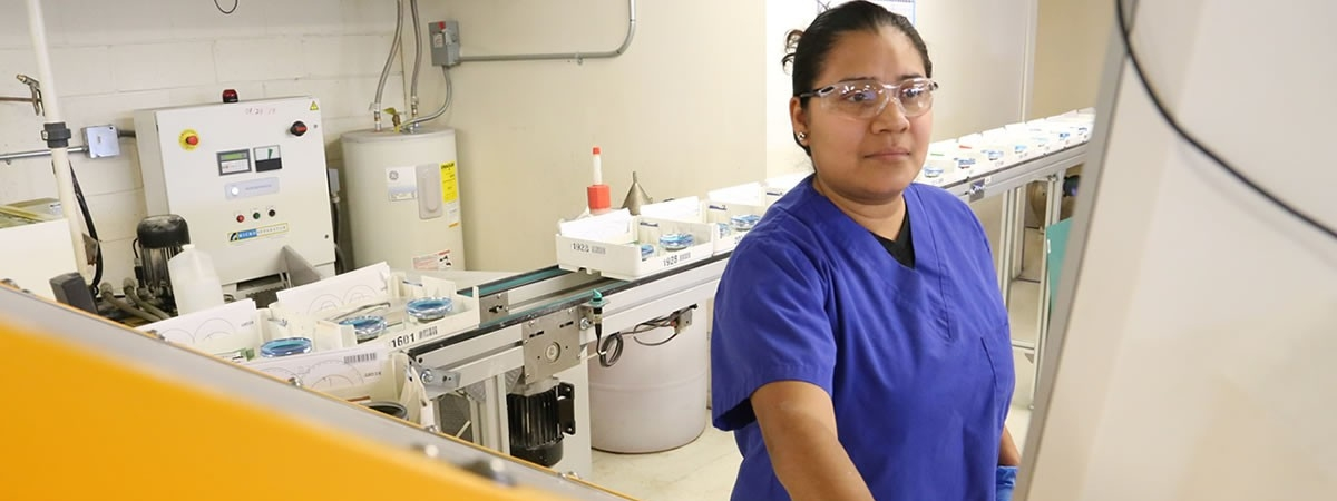 picture of person at lab machinery